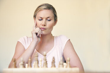 Portrait of woman playing chess - RMAF000034