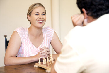 Portrait of woman playing chess with her husband - RMAF000037