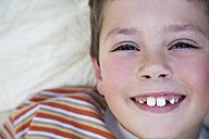 Portrait of smiling little boy with tooth gap - RMAF000052