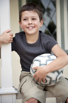 Portrait of smiling little boy with soccer ball - RMAF000064
