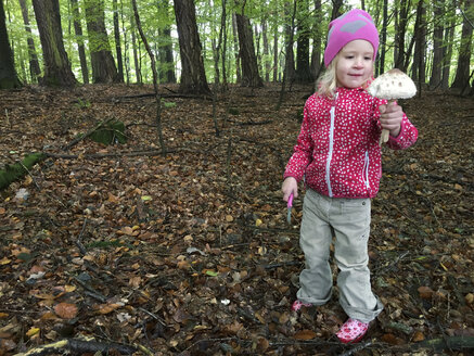 Young girl with mushroom in the woods, Waldenburger Berge, Germany - ALF000608