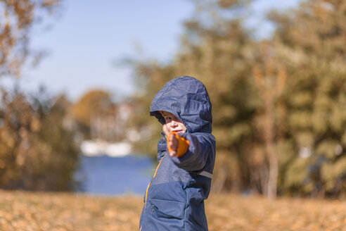 Little boy with rain jacket in the nature - MMFF001268