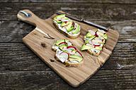 Avocado radish bread on chopping board - SARF002245