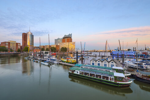 Germany, Hamburg, Hanseatic Trade Center, Elbphilharmonie and harbor in the evening - RJ000523