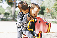 Two happy boys playing at the playground - EBSF000991