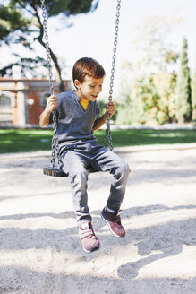 Boy on a swing at the playground - EBSF000994