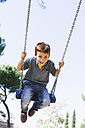 Happy boy on a swing at the playground - EBSF001000
