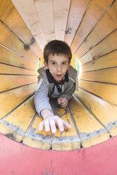 Boy in a tunnel at playground - DEGF000574