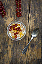 Glass of yogurt with muesli, cornflakes and red currants - LVF004091
