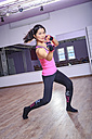 Asian woman exercising piloxing - VT000456