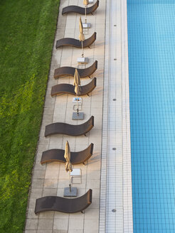 Empty sun loungers at the poolside - LA001525