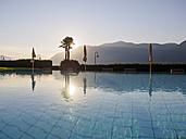 Switzerland, Ticino, Lago Maggiore, swimming pool at lakeside - LAF001534
