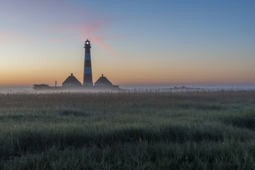 Germany, Schleswig-Holstein, North Frisia, View of Westerheversand Lighthouse in the morning light - KEBF000270