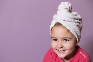 Portrait of smiling little girl wearing towel turban - ERLF000072
