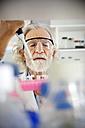 Senior professor filling sample glasses in laboratory - RMAF000183