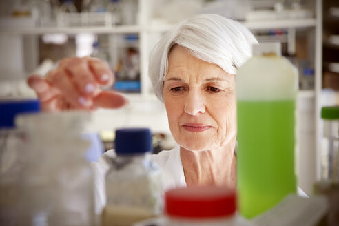 Senior woman working at chemical laboratory - RMAF000189