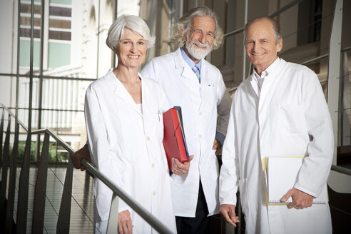 Three senior wearing laboratory coats at university - RMAF000201
