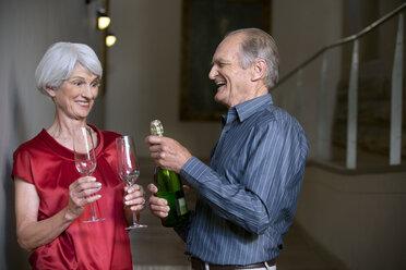 Senior couple celebrating with champagne - RMAF000216