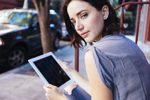 USA, New York City, portrait of woman with digital tablet - GIOF000382