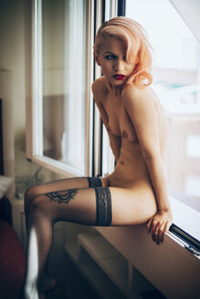 Nude young woman with stockings sitting at the window - EHF000314