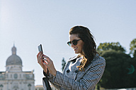 Italy, Vicenza, smiling woman taking a selfie with cell phone - GIOF000460