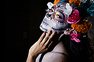 Woman dressed as La Calavera Catrina, Traditional Mexican female skeleton figure symbolizing death - ABAF001945