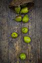 Wickerbasket and organic Bonne de Longueval on dark wood - LVF004132