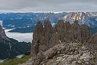Italy, Alto Adige, Dolomites, view to Cadini di Misurina mountains at sunrise on a cloudy day - LOMF000075