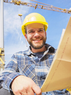 Portrait of smiling foreman with construction plan - LAF001545