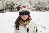 Young woman in winter wearing wooly hat covering her eyes - SKCF000024
