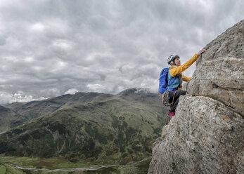 UK, Lake District, Great Langdale, woman scrambling at Pike of Stickle - ALRF000094