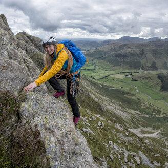 UK, Lake District, Great Langdale, woman scrambling at Pike of Stickle - ALRF000103
