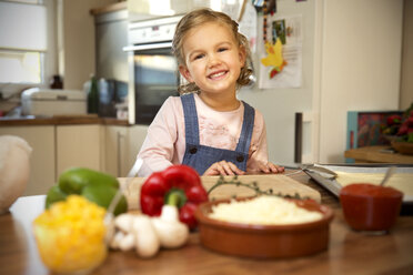 Portrait of smiling girl in kitchen - TOYF001512