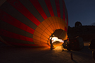 Turkey, Anatolia, Cappadocia, hot air ballon is being prepared - FC000792