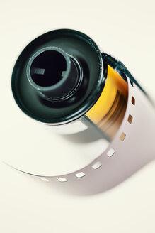 Negative film in front of light background, close-up - JATF000763