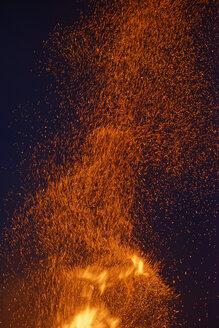 Germany, Bavaria, Midsummer bonfire at night - LHF000481