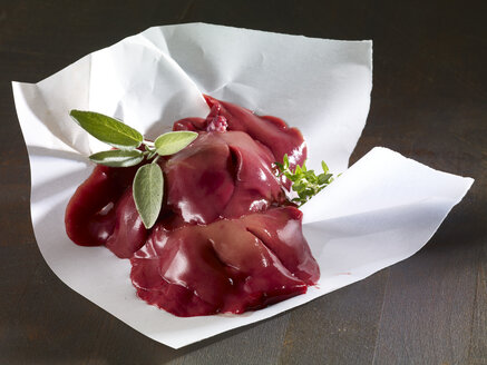 Raw rabbit liver and sage on paper - SRSF000604