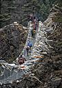 Nepal, Himalaya, Khumbu, trekkers crossing a bridge - ALR000114