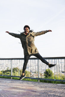 Spain, Barcelona, portrait of happy young man jumping in the air - EBSF001053
