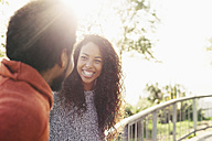 Portrait of happy young woman face to face with her boyfriend - EBSF001065
