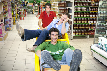 Three friends having fun together in a supermarket - RMAF000239