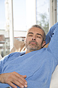 Mature man relaxing at home - FKF001571