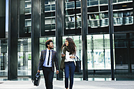 Two young business people walking outdoors - EBSF001120