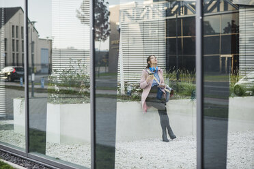 Young woman in atrium of a building - UUF006070