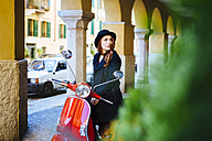Italy, Verona, young woman with scooter - GIOF000524