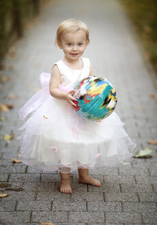 Portrait of blond little girl with ball wearing tulle dress - NIF000057