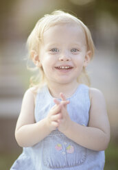 Portrait of smiling blond little girl wearing summer dress - NIF000066