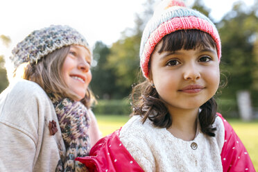 Two little girls wearing woolly hats - MGOF001062