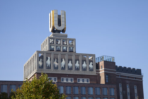 Germany, Dortmund, view to Dortmund U-Tower with artwork of Adolf Winkelmann - WI002926