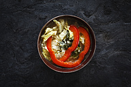 Bowl of vegan Chinese cabbage stew with tofu and slices of red bell pepper - EVGF002512